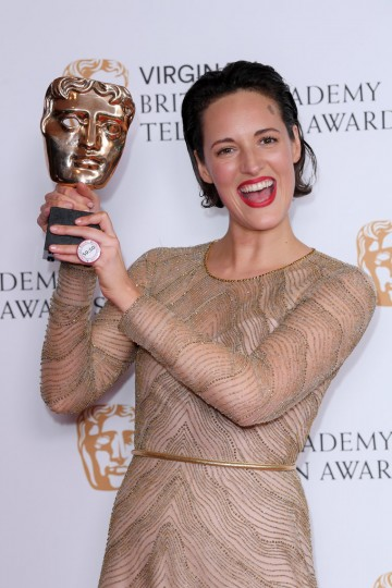 Phoebe Waller-Bridge lifts her award high after winning Female Performance in a Comedy Programme for Fleabag