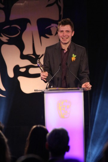 A member the development team behind The Vanishing of Ethan Carter accepts the award for Game Innovation at the British Academy Games Awards in 2015