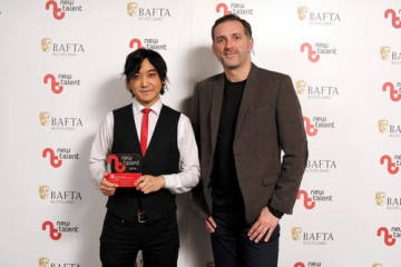 Atzi Muramatzu - Winner in the Composer Category for 'The Violinist' with presenter Stuart Fleming