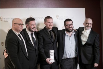 The development team at Rockstar North with their award for Special Achievement in 2013