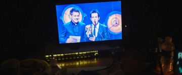 Dick & Dom present the Game award, as seen from the monitor backstage