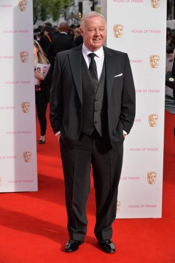 Les Dennis arrives at the red carpet outside London's Theatre Royal