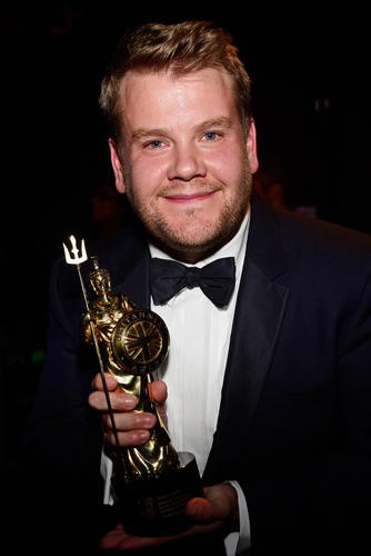 James Corden poses with the Britannia Award for British Artist of the Year presented by Burberry.