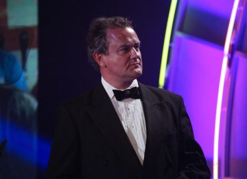 Familiar star of both the small and big screens Hugh Bonneville presents the Costume Design Award, sponsored by Swarovski. (Pic: BAFTA/Jamie Simonds)