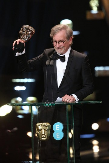 Steven Spielberg accepts the award for Supporting Actor on behalf of Mark Rylance at the 2016 EE British Academy Film Awards
