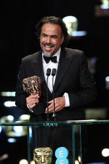 Alejandro G Iñárritu celebrates willing the Director award at the 2016 EE British Academy Film Awards