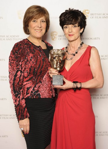 Winner of the Production Design BAFTA for Gracie!, Claire Kenny, with category presenter, actress Lynda Bellingham.