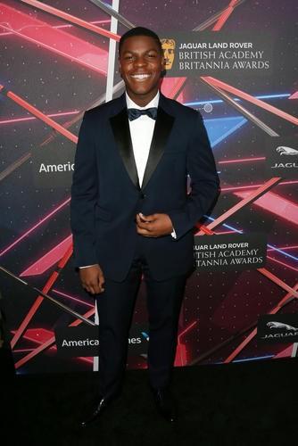 Star Wars: The Force Awakens star John Boyega on the red carpet. He stars alongside honoree Harrison Ford in the upcoming film.