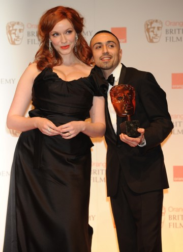 Presenter Christina Hendricks with the Brit actor and filmmaker who won the public vote.
