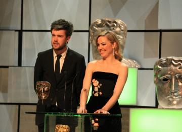 Jack Whitehall and Melissa George accepted Graham Norton's BAFTA Entertainment Performance in his absence.