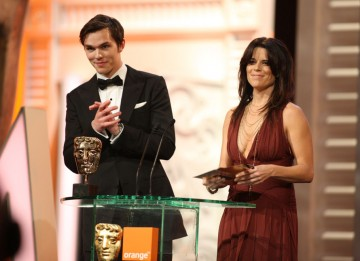 Nicholas Hoult (X-Men: First Class) and Neve Campbell (Scream 4) announce the Animated Feature winner. (Pic: BAFTA/ Stephen Butler)