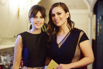 Leading Actress nominee Felicity Jones and Animated Film presenter Hayley Atwell backstage in the J. Kings Smoking Room at London's Royal Opera House.