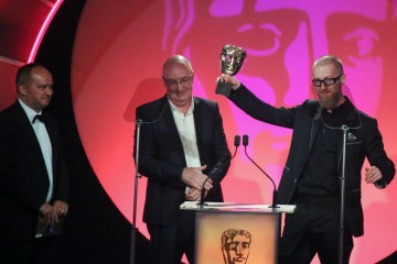 Mark Roalfe, Tomek Baginski and Ron Chakraborty accept the award for Titles & Graphic Identity at the British Academy Television Craft Awards in 2015