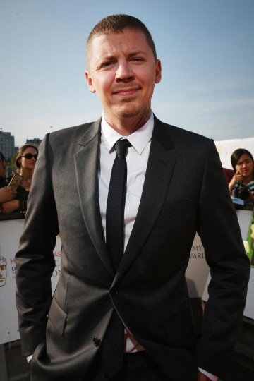 Professor Green smiles for the camera on the red carpet