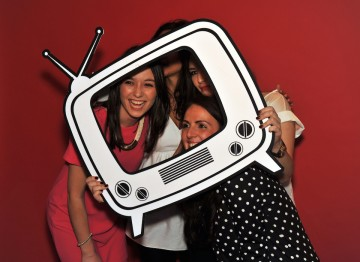 Party attendees posing for the camera at our Boothnation photobooth