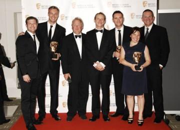 The X Factor team celebrate winning the Factual Series Award with citation reader Robert Webb ( BAFTA/Richard Kendal)