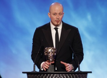 A representative from EA Games accepts the award for Left 4 Dead 2, winner of the Multiplayer category (BAFTA/Brian Ritchie)