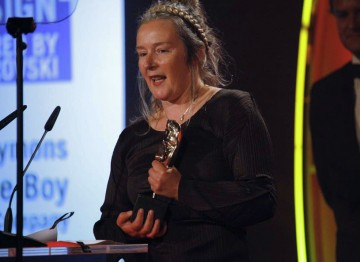Costume designer Charlotte Walter accepts this award for her work on This Is England '86. (Pic: BAFTA/Jamie Simonds)