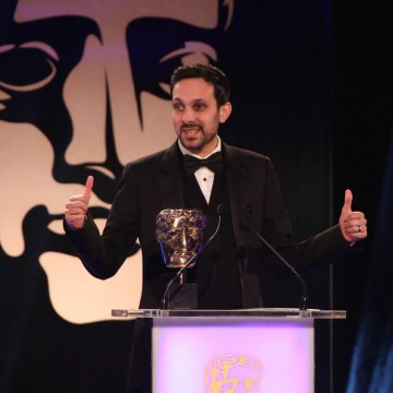 Dynamo presents the award for Best Game at the British Academy Games Awards in 2015