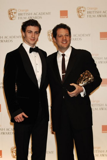 Michael Giacchino, winner of the Music award for his score in UP, stands with Aaron Johnson (BAFTA/Richard Kendal).