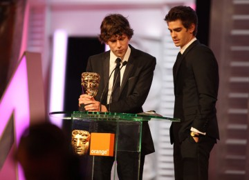 "The Social Network co-stars Jesse Eisenberg and Andrew Garfield accept David Fincher's BAFTA on his behalf. "" I know David would first and foremost want to thank Aaron Sorkin for his incredible screenplay, which is as exhilarating to read as it is to perf"