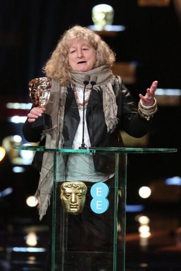Jenny Beavan, costume designer for Mad Max: Fury Road, accepts the award for Costume Design at the 2016 EE British Academy Film Awards