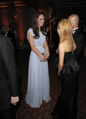 The Duchess of Cambridge greets the owners of the Belasco Theatre,  Mr. and Mrs.Kim
