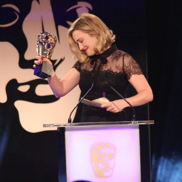Ashley Johnson accepts the award for Story for The Last of Us: Left Behind at the British Academy Games Awards Ceremony in 2015