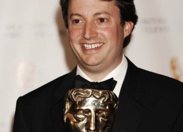 David Mitchell, winner of the Comedy Performance Award for his role in Peep Show, celebrates backstage at the British Academy Television Awards in 2009 (BAFTA / Richard Kendal).