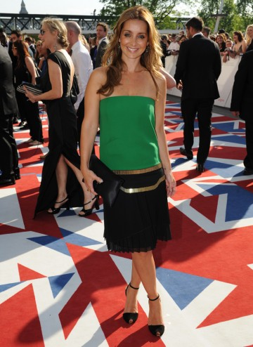 The singer and TV presenter strikes a pose in a Gucci dress.