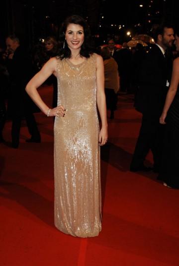 British actress Jodie Whittaker in a glittering gold Escada dress (BAFTA/Richard Kendal).