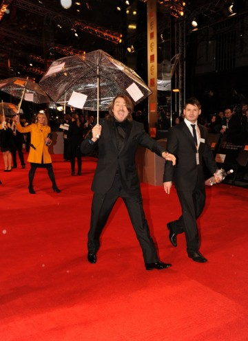 Host Ross greets fans and makes a dash across the red carpet. (Pic: BAFTA/Richard Kendal)