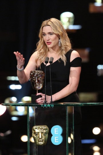 Kate Winslet accepts the award for Supporting Actress at the 2016 EE British Academy Film Awards