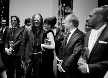 The winners of the Orange British Academy Film Awards in 2009 gather on stage for a group photo (Greg Williams / Art+Commerce).
