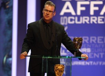 Culture Show presenter Mark Kermode awards the Dispatches team the Current Affairs BAFTA. (BAFTA/Steve Butler)