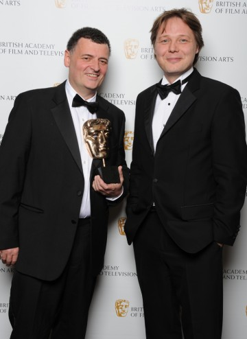 Stephen Moffat, winner of the Writer BAFTA, poses with actor and Award presenter Shaun Dooley