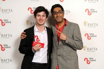 Benjamin Cresswell - Winner in the Animation Category for 'The Armadillo and the Earwig' with presenter Sanjeev Kohli