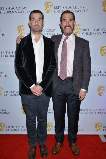Twins Chris and Xand van Tulleken, presenters of Operation Ouch!, may look alike, but their reactions to arriving at the British Academy Children's Awards in 2014 are fairly different