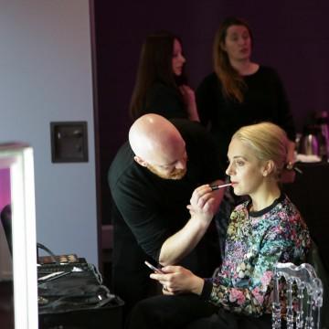 A M.A.C. makeup artist prepares Amanda