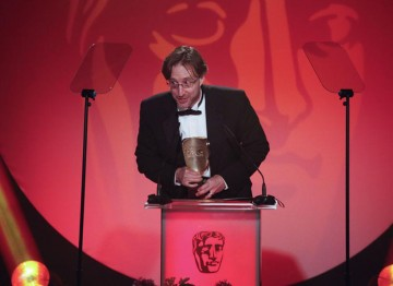 Jason Savage accepts this award for his work editing the factual television programme Human Planet (Arctic). (Pic: BAFTA/Jamie Simonds)