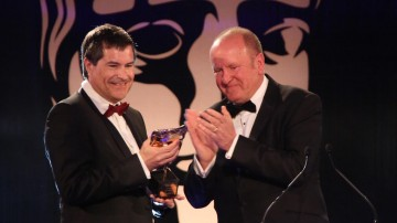 Ian Livingstone presents the Games Fellowship to David Braben at the British Academy Games Awards in 2015