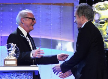 Barry Levinson welcomes colleague and friend Warren Beatty to the stage