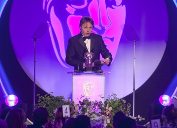 Great Expectations Actor Shaun Dooley presents the BAFTA for Writer.