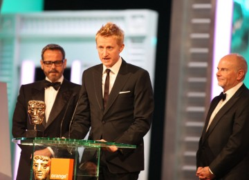 Guy Hendrix Dyas, Larry Dias and Doug Mowat take the BAFTA for their exceptional work on Inception. (Pic: BAFTA/ Stephen Butler)