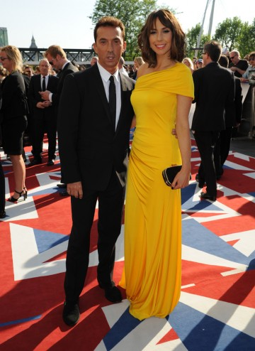 The Strictly Come Dancing judge and co-presenter of  The One Show will present the Soap and Continuing Drama BAFTA. Alex wears Ariella Couture and Bruno a Dolce and Gabbana suit.