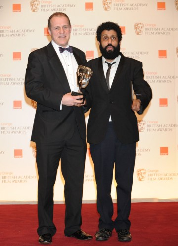 Four Lions actors Nigel Lindsay and Adeel Akhtar accept on behalf of writer/director Chris Morris. (Pic: BAFTA/ Richard Kendal)