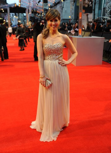 TV personality Rachel Stevens, one of the many red carpet reporters at this year's Film Awards. Stevens is wearing a dress by Isabel Morant, with accessories by Asprey. (Pic: BAFTA/Richard Kendal)
