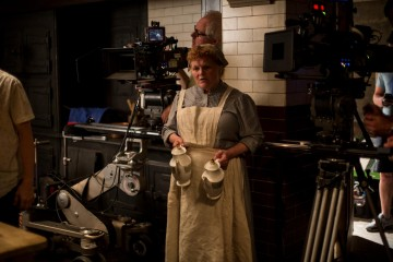Lesley Nicol pictured in a behind the scenes photograph as Mrs Patmore, Downton Abbey's cook.