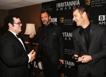 Southpark creators Trey Parker and Matt Stone keep the jokes coming backstage at the Britannias with Josh Gad.