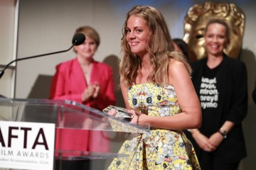 Filmmaker Rikke Gregersen accepts the Special Jury Winner award